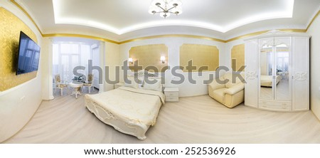 Luxurious bed with cushion in royal bedroom interior. Panorama hotel room in gold tones - stock photo