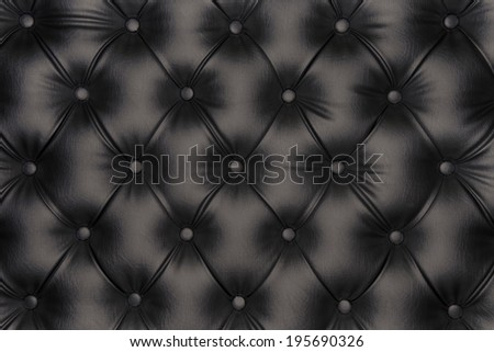 Luxurious black-tone leather texture furniture with buttons - stock photo