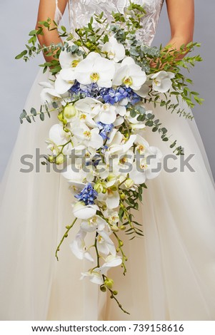 Luxurious bouquet of the bride from orchids and hydrangeas close-up