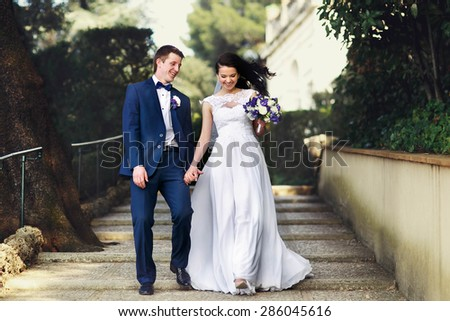 luxurious bride and groom walking spring park of tivoli italy