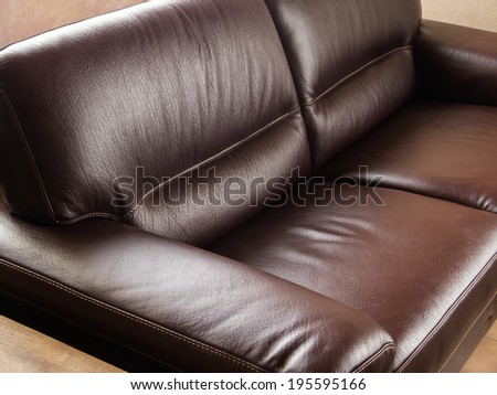 Luxurious classic brown leather couch - stock photo