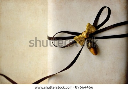 Luxurious Gift Box with brown ribbon and brooch on vintage background