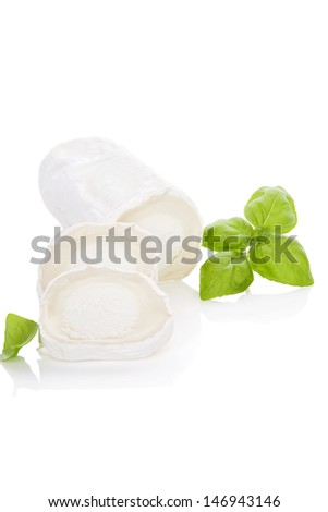 Luxurious goat cheese with basil herbs isolated on white background. Culinary cheese eating. - stock photo