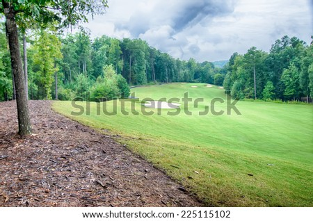 luxurious golf course on a cloudy day - stock photo