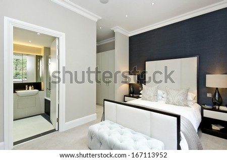 Luxurious hotel style double bedroom with king size bed, luxury designer furniture and private ensuite