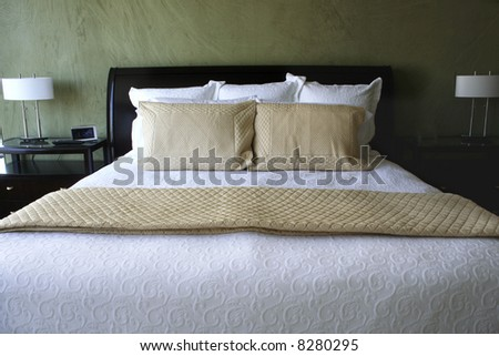 Luxurious king sized bed - stock photo