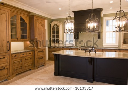 luxurious kitchen with custom cabinets - stock photo