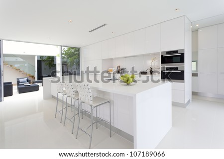 Luxurious kitchen with stainless steel appliances in Australian mansion - stock photo