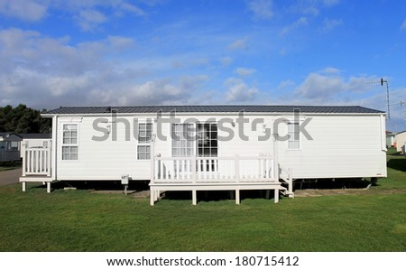 Luxurious modern caravan on English trailer park. - stock photo
