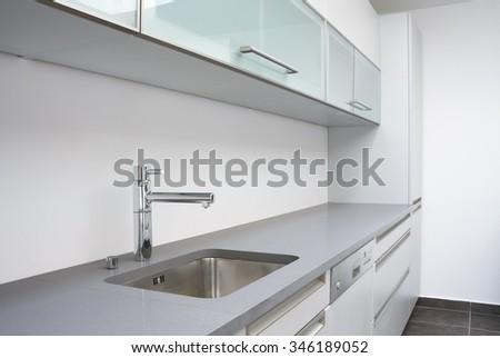 Luxurious modern kitchen with sink - stock photo