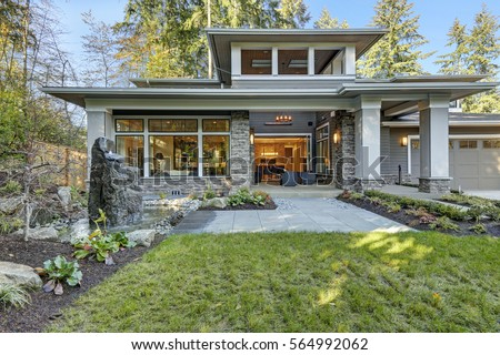 Luxurious New Construction Home Exterior With Front Patio And Perfect Landscape  Design: Nice Garden Pond