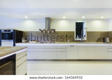Luxurious new kitchen with LED lights and modern appliances - stock photo