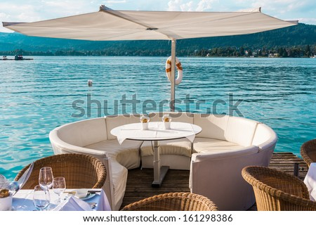 Luxurious restaurant with tables on pier at a Lake in Austria - stock photo