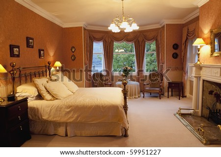 Luxurious Victorian bedroom with a big brass bed. Victorian Room Stock Photos  Royalty Free Images   Vectors