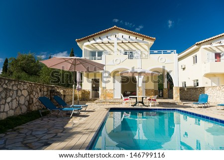 Luxurious villa with pool resort in Greece - stock photo