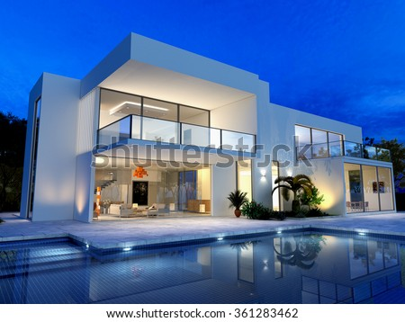 luxurious villa with swimming pool at dusk - stock photo