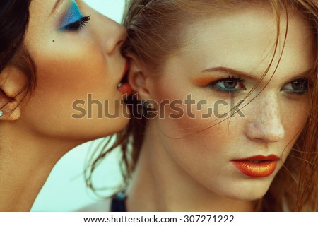 Luxurious weekend.concept. Beautiful couple of fashionable models with perfect arty make-up. Wet hair, waterproof decorative cosmetics. Close up. American disco (vintage) style. Outdoor fashion shot - stock photo