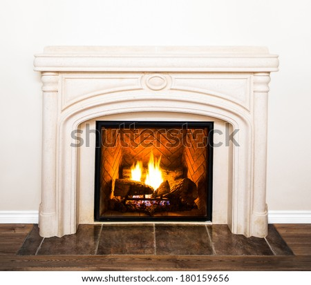 Luxurious White Marble Fireplace Detail and empty white wall - stock photo