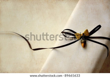 Luxurious White Present with Ribbon on grunge background