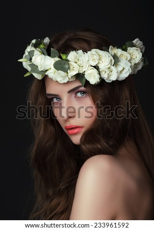 Luxurious Woman in Chaplet of Fresh Flowers - stock photo