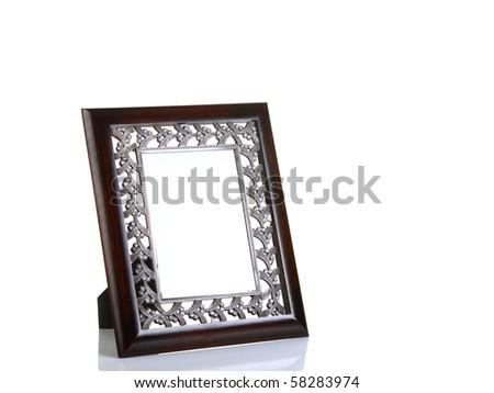 Luxurious wooden empty photo frame isolated on white - stock photo