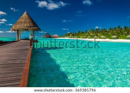 Luxurious wooden outdoor overwater spa on a tropical atol in Maldives - stock photo