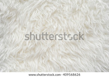 Luxurious wool texture from a  sheepskin rug - stock photo
