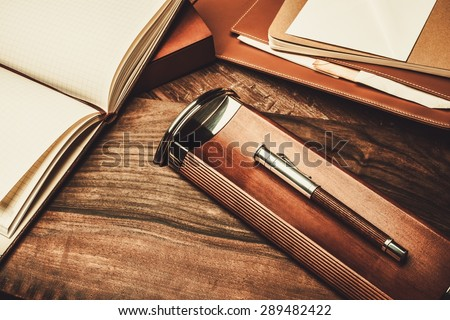Luxurious writing tools on a wooden table  - stock photo