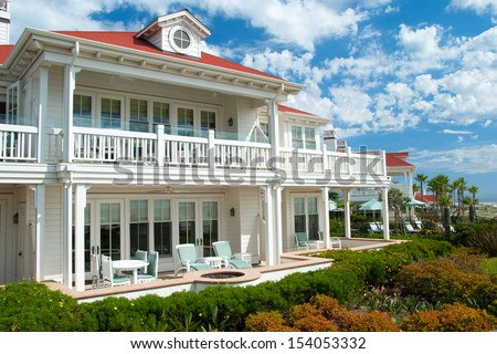 Luxury american dream beach summer house with beautiful blue sky in background.