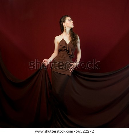 Luxury and beautiful woman posing on red backgrounds - stock photo