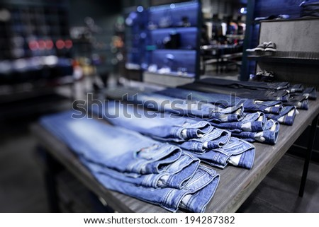 luxury and fashionable brand new interior of cloth store - stock photo