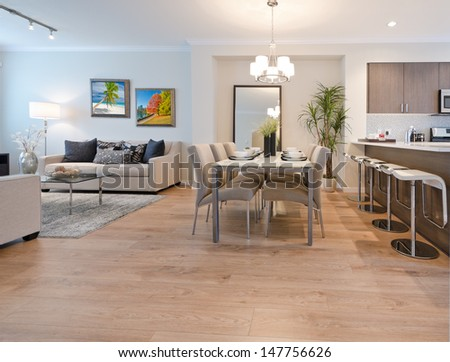 Luxury and nicely decorated living set, lunch room with the table with the coffee, tea set and the living suite, room and the kitchen aside . Interior design. - stock photo