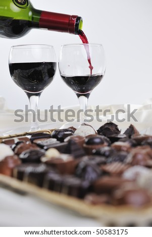 luxury and sweet praline and chocolate with wine bottle and glasses  decoration - stock photo