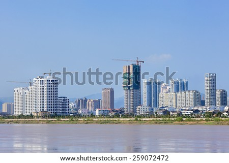 Luxury apartment buildings with a river view, Wenzhou, Zhejiang Province, China - stock photo