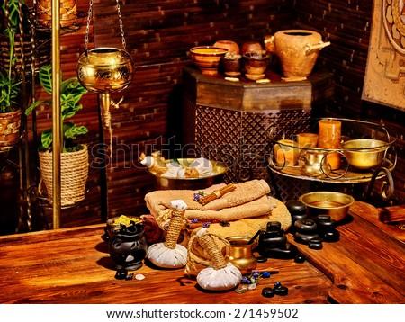 Luxury ayurvedic spa massage still life. Oil lamp. - stock photo