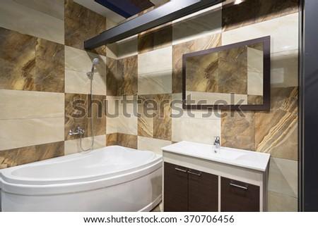 Luxury bathroom interior with bath tub - stock photo