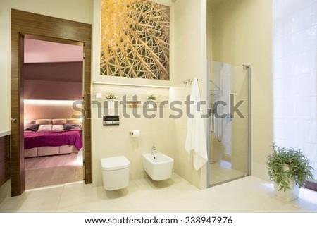 Luxury bathroom open on bedroom in big modern house - stock photo