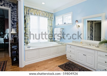 luxury bathroom remodel with tub and white cabinets - stock photo