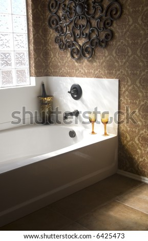 Luxury bathroom with champagne and glasses - stock photo