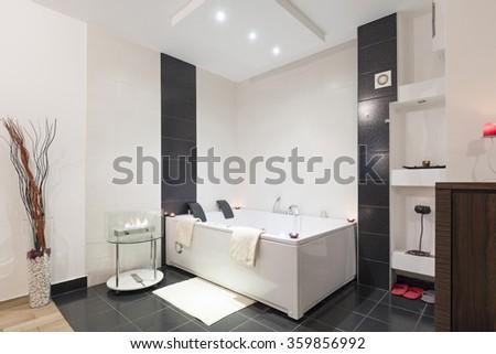 Luxury bathroom with jacuzzi bath - stock photo