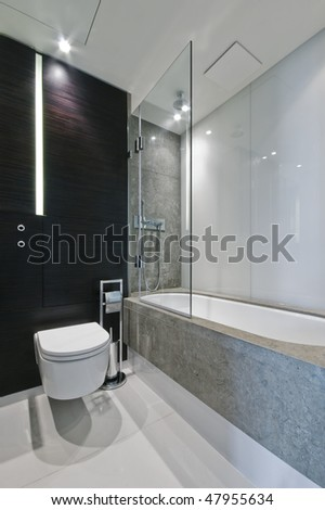 luxury bathroom with marble tiles and hard wood elements