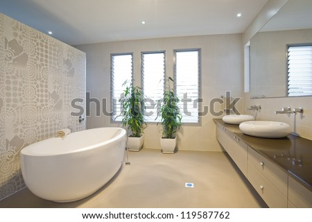 Luxury bathroom with twin sinks - stock photo