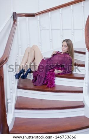 Luxury beautiful young woman on staircase