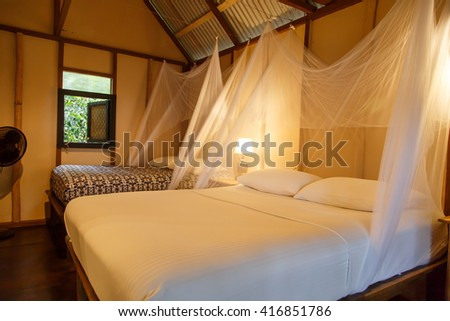 luxury bed on room from a tropical paradise