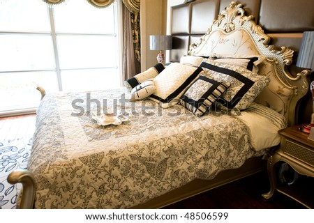 luxury bedroom interior with breakfast on bed. - stock photo