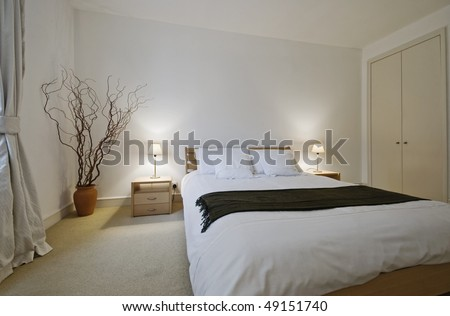 luxury bedroom with modern furniture and built-in wardrobe - stock photo