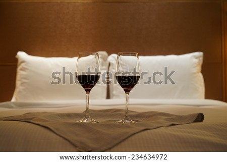 Luxury bedroom with red wine as background. - stock photo