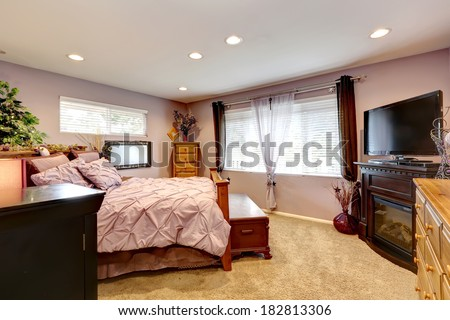 Luxury bedroom with rose walls and gentle bedding.