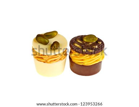 Luxury black and white chocolate sweets with pistachio - stock photo