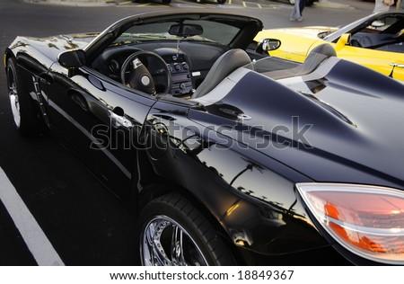 Luxury black convertible sports car - stock photo